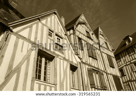 Old half timbered houses in medieval town of Auxerre (Burgundy, France).  Aged photo. Sepia. - stock photo
