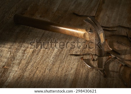 old hammer and rusty nails