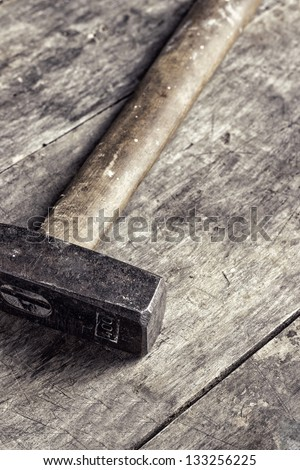 old hammer on old table,close up