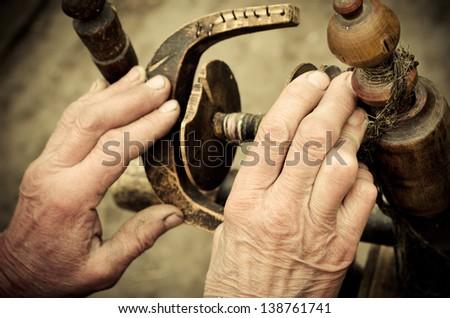 old hand at distaff closeup - stock photo