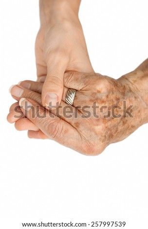 Old hand holding young hand - stock photo