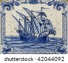 Old hand painted art tile (azulejo) representation of Portuguese discoveries. - stock photo