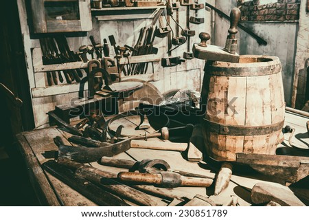 Old hand tools in vintage workshop  - stock photo