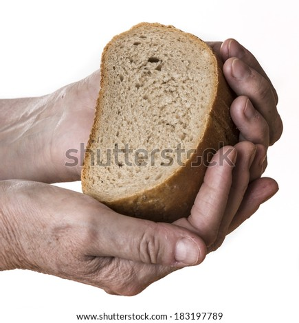 old hand with bread - stock photo
