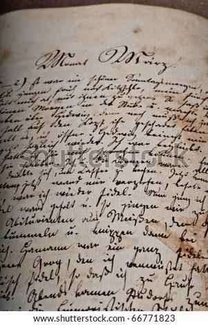 Old hand-written manuscript in old German script - stock photo