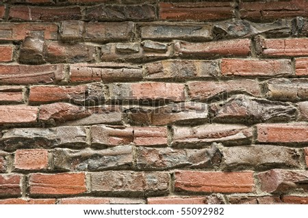 Old Handmade Brick Wall - stock photo