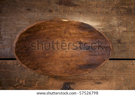 old handmade carved wooden bowl on old table, stylish! - stock photo