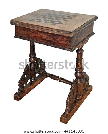 Old handmade Chess table on carved lacquered legs, isolated on white