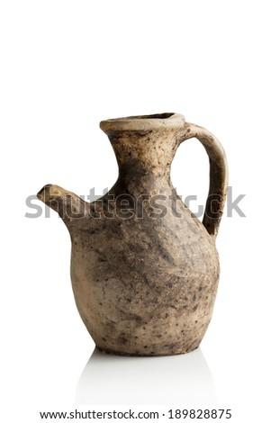 Old handmade clay jug - stock photo