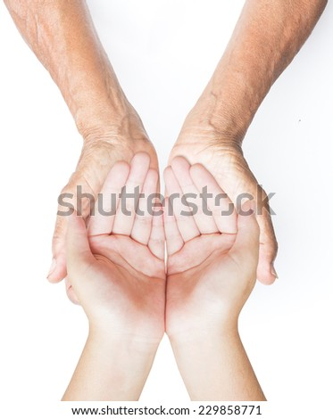 Old hands holding hands of young man - stock photo