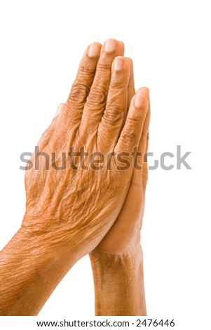Old hands praying - stock photo