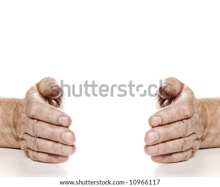 Old hands with copy-space between them. Isolated on white background - stock photo