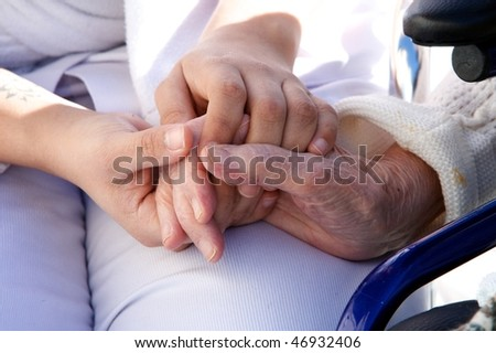 old hands with medical personel - stock photo