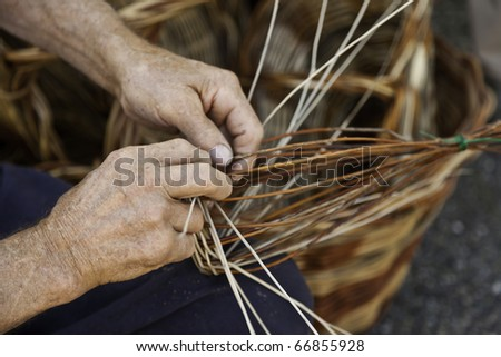 Old hands working in a basket costruction