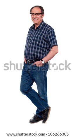 Old handsome man standing in style with hands in pocket. Full length shot - stock photo