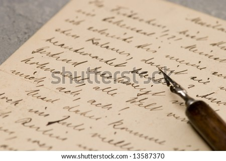 old handwritten letters and pen