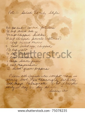 old handwritten potato salad recipe, layered with textures of stained paper - stock photo