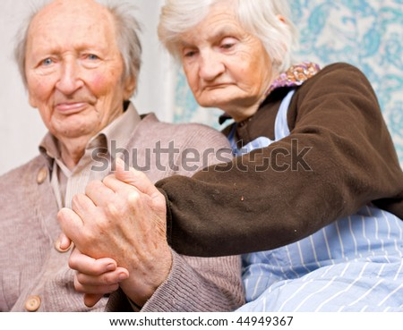 Old happy grandparents staying together
