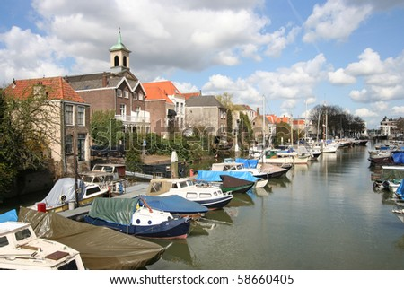 Old harbor with boats in Dordrecht, Holland