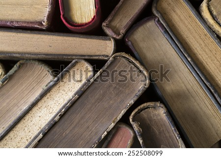 Old hardback books seen from above - stock photo