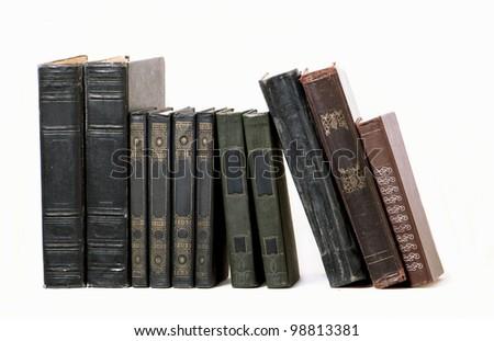 Old hardcover books on bookshelf - stock photo