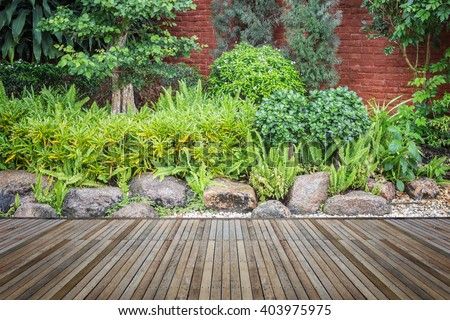 Old hardwood decking or flooring and plant in garden decorative