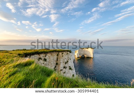 Old Harry Rocks, steep chalk cliffs and sea stacks near Swanage on Dorset's Jurassic Coast - stock photo