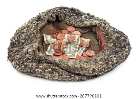 Old hat with donated money isolated on white background - stock photo