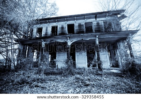Old haunted house in the woods - stock photo