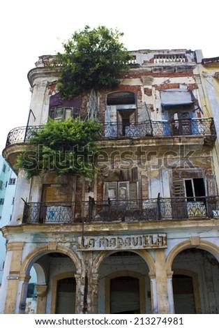 Old Havana, Cuba, August 11, 2012: La Maravilla, in English splendor, decaying building, a very ruined palace in the street of Old Havana, Cuba - stock photo