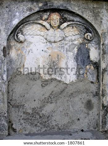 old head stone  with cherub; child - stock photo