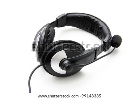 Old headphones on white background