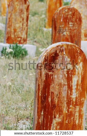 Old headstones in the Scofield, Utah cemetery of miners that died May 1, 1900 in a coal mine disaster. - stock photo