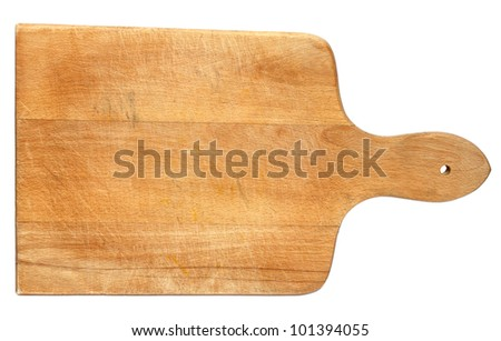 Old heavily used chopping or cutting board on white background - stock photo
