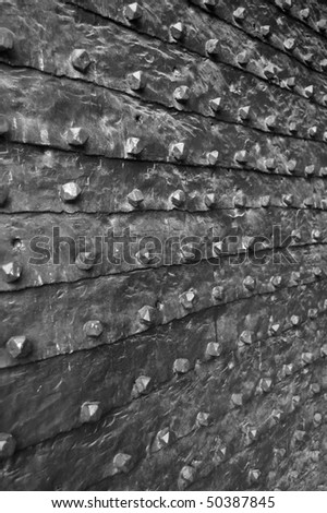 Old heavy iron gate of middle age fortress - B&W - stock photo