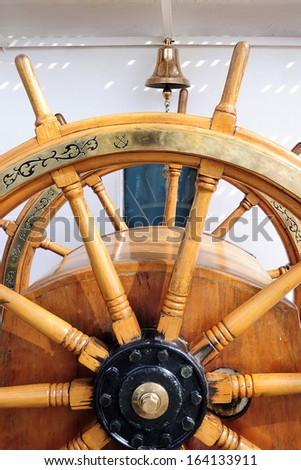 Old helm of sailing boat - stock photo