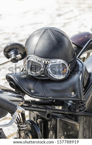 Old helmet on a motorcycle - stock photo