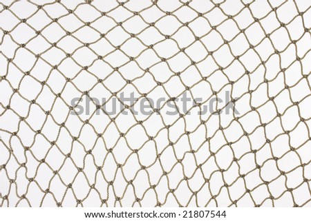 Old hemp fishing net against a white background. - stock photo