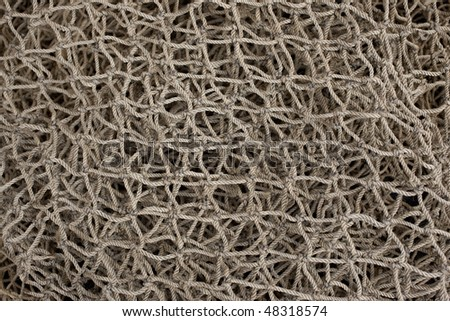 Old hemp fishing net. Selective focus in center. Horizontal or vertical format. - stock photo