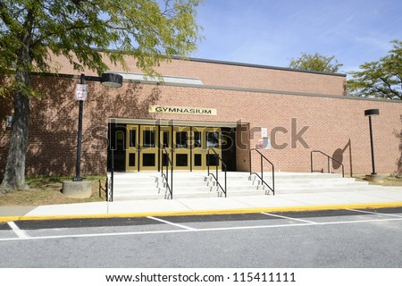 old high school gymnasium entrance - stock photo