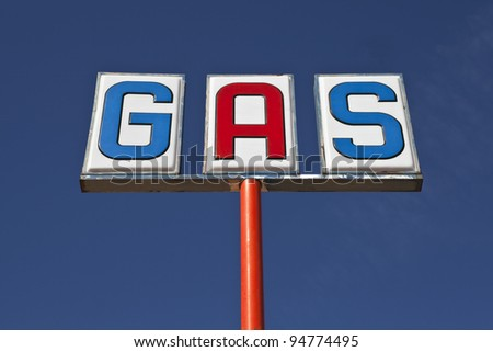 Old highway gas sign in the Mojave Desert. - stock photo
