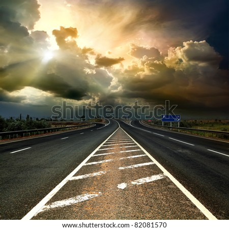 Old highway in storm weather - stock photo