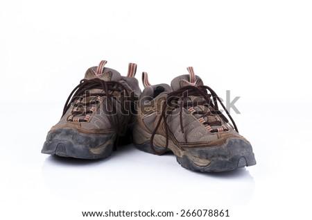 Old hiking shoe isolated on white background  - stock photo