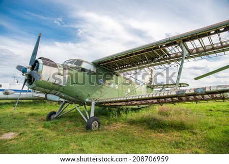 old historic airplane on the ground - stock photo