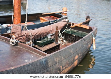 Old historic fishing ships in harbor of Urk, the Netherlands - stock photo
