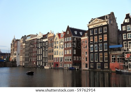 Old historic houses in Amsterdam, Netherlands, Europe. - stock photo