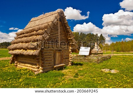 old historic huts - stock photo