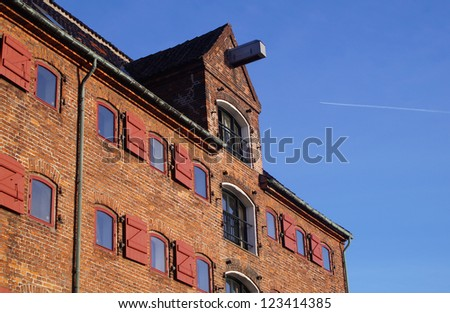 Old historic storehouse close to Nyhavn harbor - stock photo