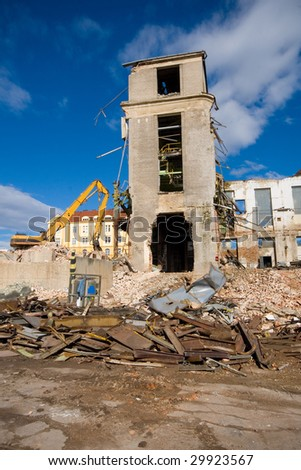 Old historical building winding up and demolition - stock photo