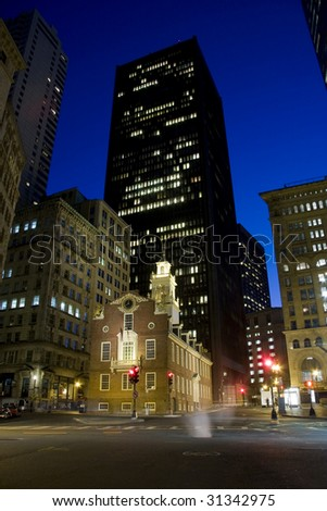 Old historical State House public building surrounded by skyscrapers - stock photo